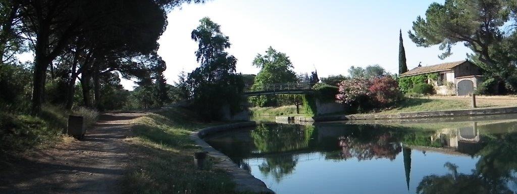 Point de rencontre avec le Canal du Midi. Ecluse de Cesse, maison éclusière