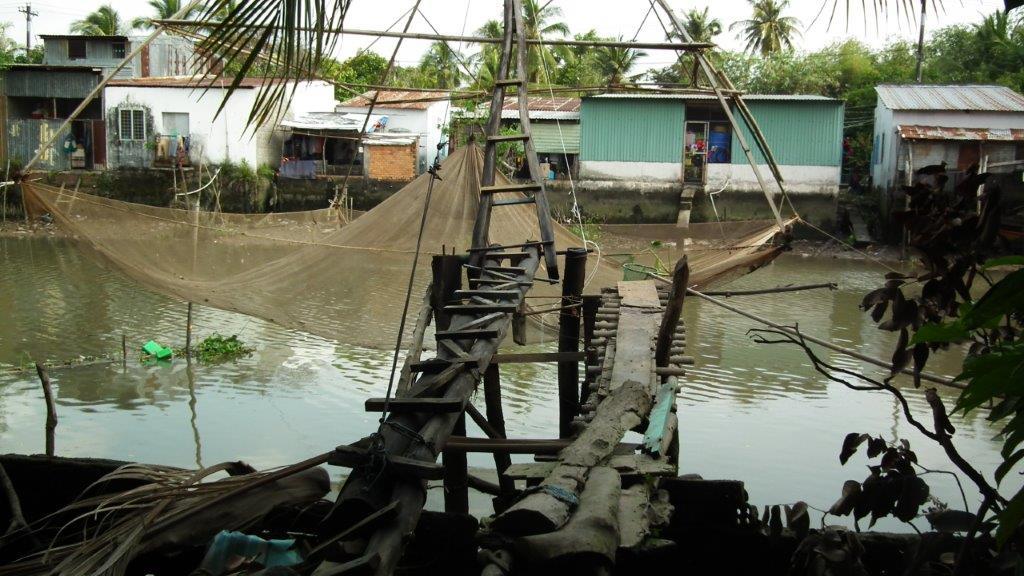 Pêche au filet sur le delta du Mékong